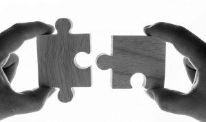 Macro shot of jigsaw puzzles teamwork concept